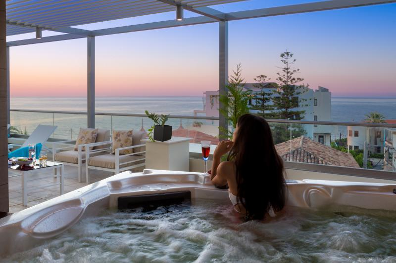 enjoy the sunset over the Mediterranean Sea from the inside of a jacuzzi