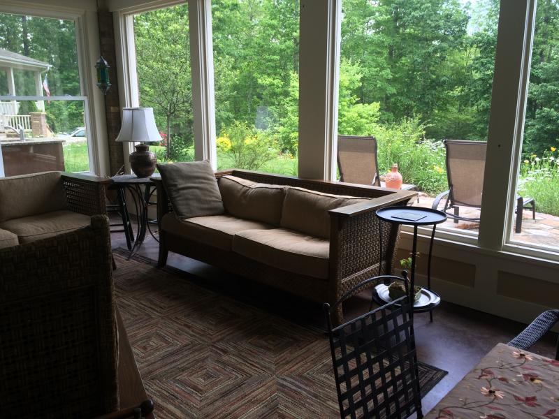 Bonus room interior with fireplace