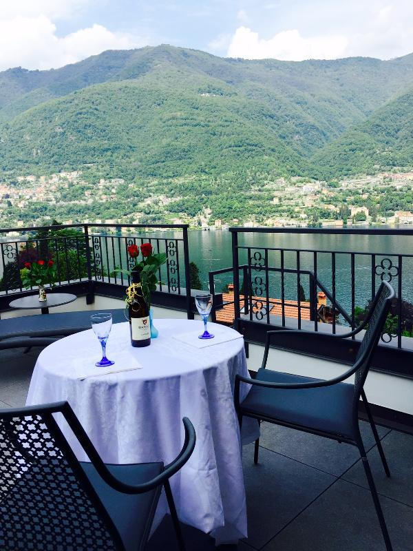 Sip on a glass of wine while enjoying the incredible view from your private terrace