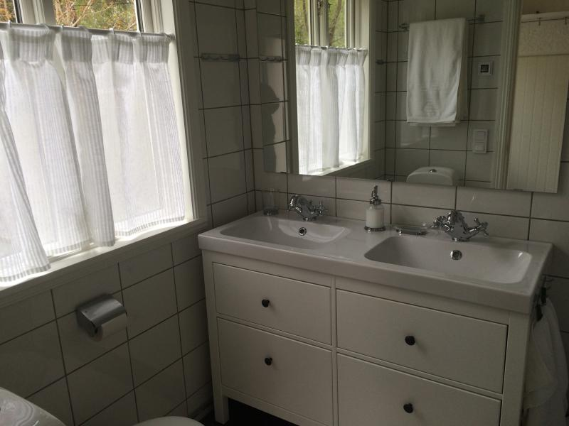 Bathroom has shower, washer and dryer