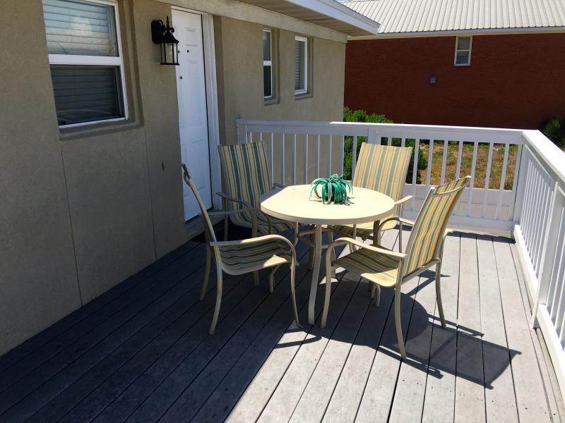 Back balcony with Outdoor table and chairs.