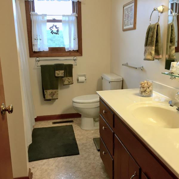 Full bath serves two bedrooms (full and twin) as well as guests.  Located off hallway.