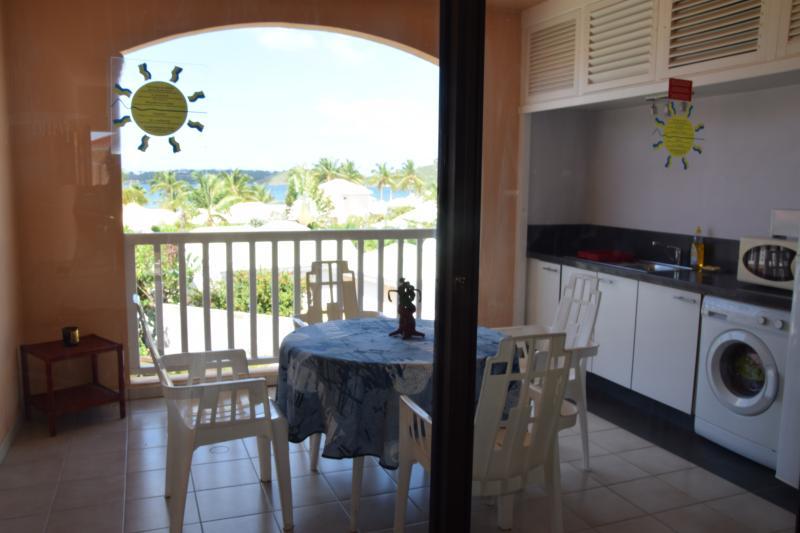 cook on the balcony with 2 hob, microwave, big fridge, washing machine, sunset and lagoon's view
