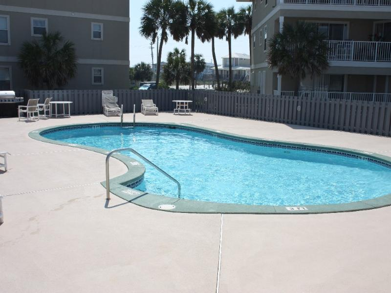 Enjoy the sparkling pool, complete with lounge chairs, restroom and grill!
