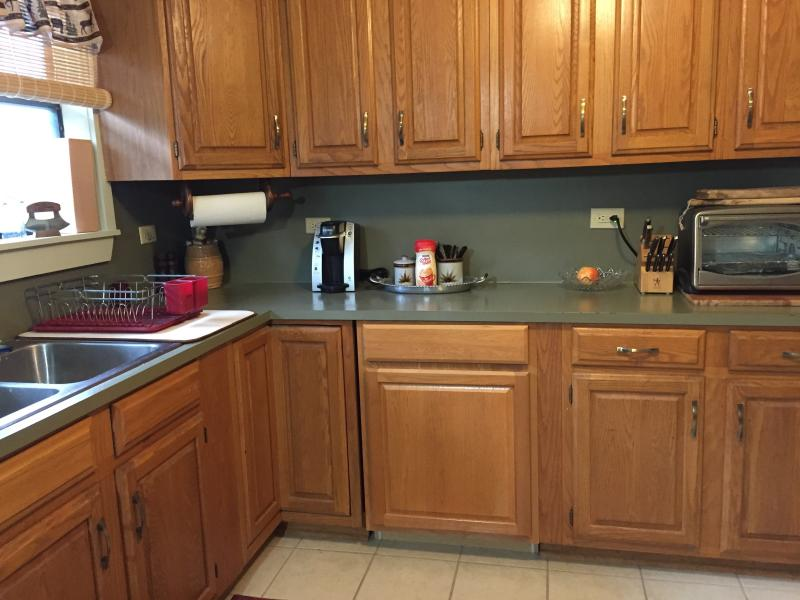 Large kitchen will full-size stove and refrigerator. Pots, plates, silverware, etc. available.