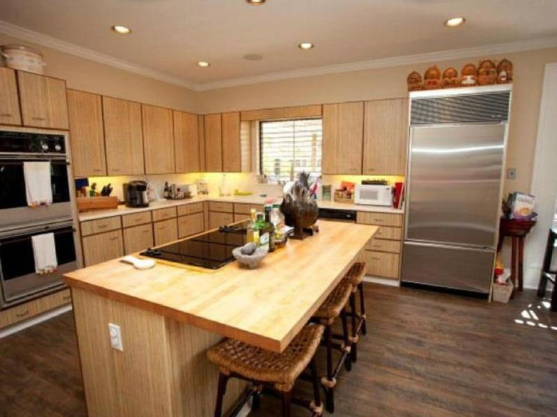 open kitchen with original St. John cabinets and SubZero
