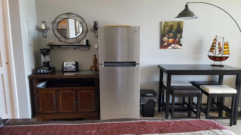 Full size refrigerator, coffee maker and toaster