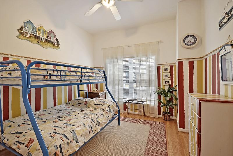 Kids room on first floor with twin over double bunk bed. Full bath is in hall just outside door.