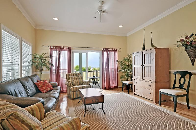 Spacious family room with access to screened-in porch.