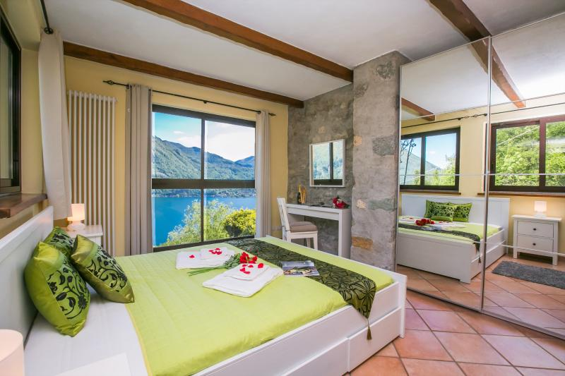 Modern master bedroom with extraordinary lake views
