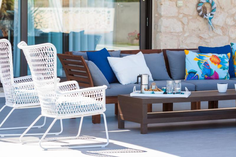 Outdoor area has plenty of seating areas with sofas and chairs