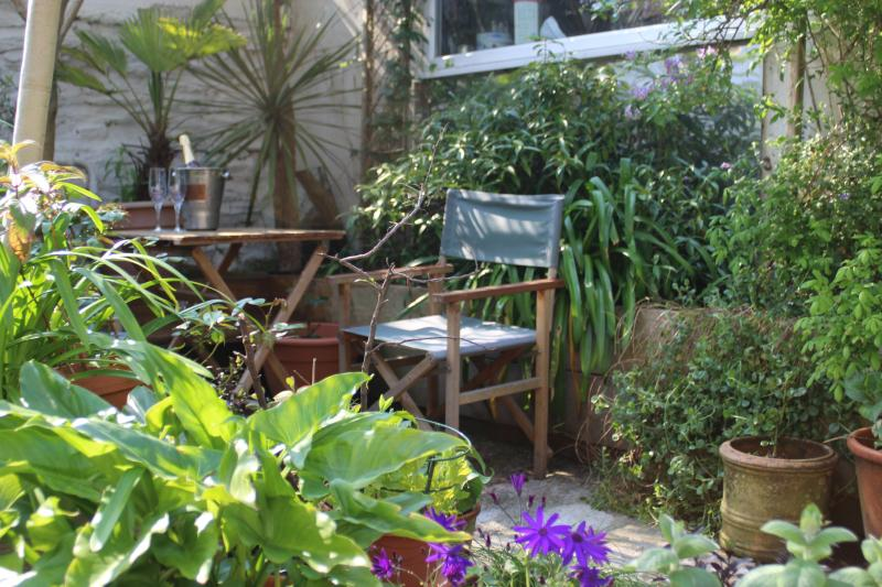 The Art Apartment is situated in a sunny courtyard garden...
