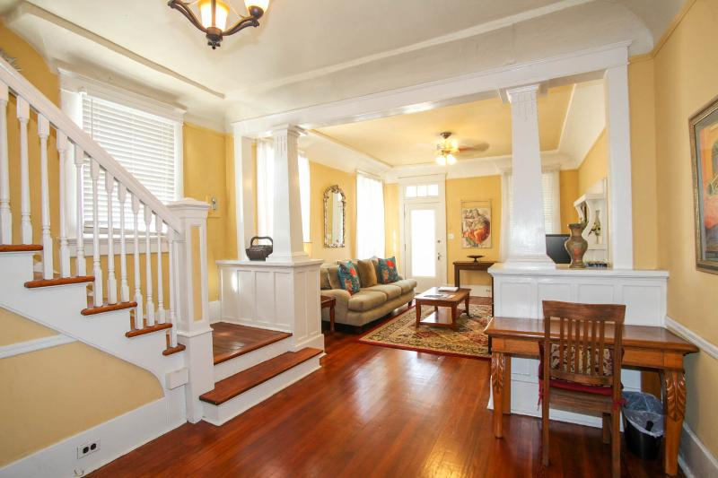 Large, Open Living Area w/ Original Fireplace, Opens to Front Porch. Central Stairway to 2nd Floor.