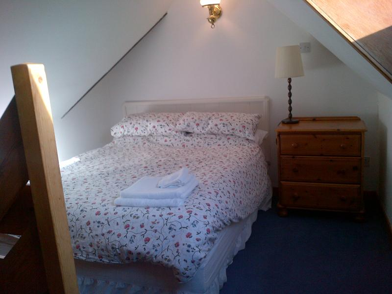 Galleried double bedroom area with velux roof window.