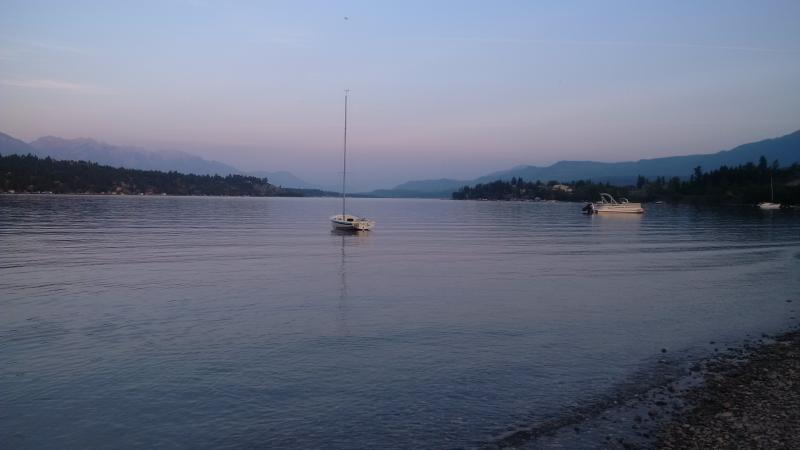 Calm water of Lake Windermere in the evening. Great place to walk to wind sown for the evening.