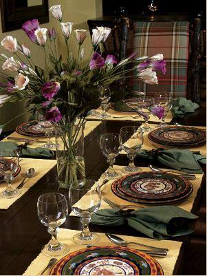 diningroom w/ placemats, chargers, dinnerware, napkins, flatware, and glasses to have meals at home