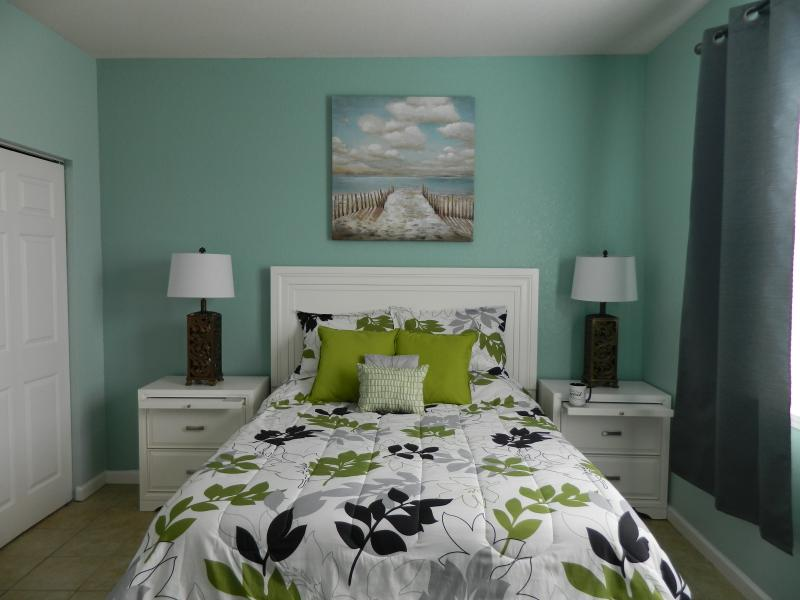 Queen bedroom with new furniture and bedding April 2016