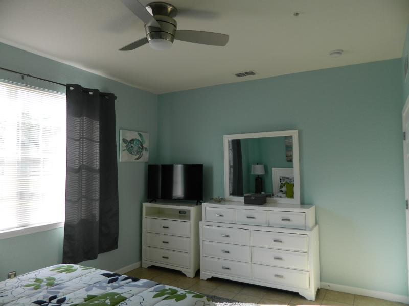 Queen bedroom with 40 inch Smart TV and remote control fan