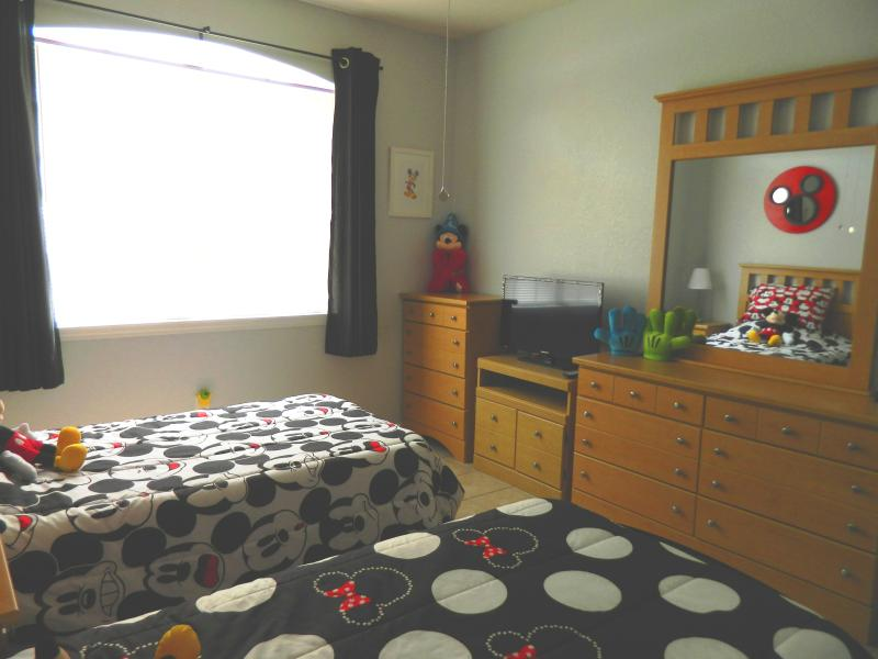 Twin room with 32 inch TV and night light that shines Mickey onto wall when lights are out.
