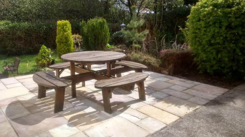 Picnic table ,patio and pond in secluded sunny area beside Apartment. BBQ, outdoor furniture