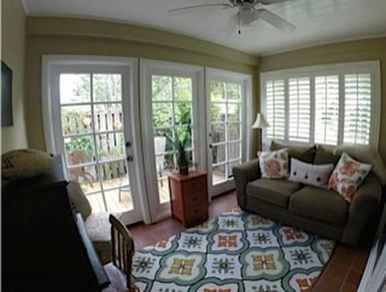 updated sun room with couch, desk