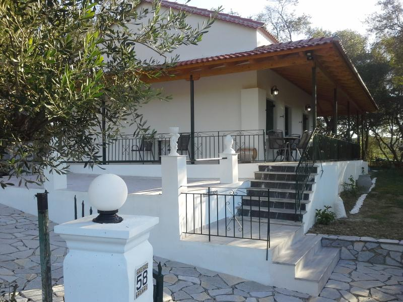 Detached two bed villa sea view set in olive groves. Golden sandy beach 450m dining & activities