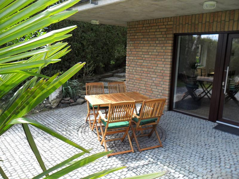 Terrace with table and four chairs.