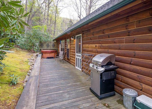 Back porch with gas grill and hot tub.
