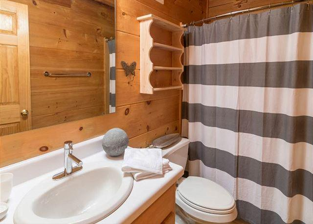 Bathroom with tub/shower combo, just outside of the bedroom.