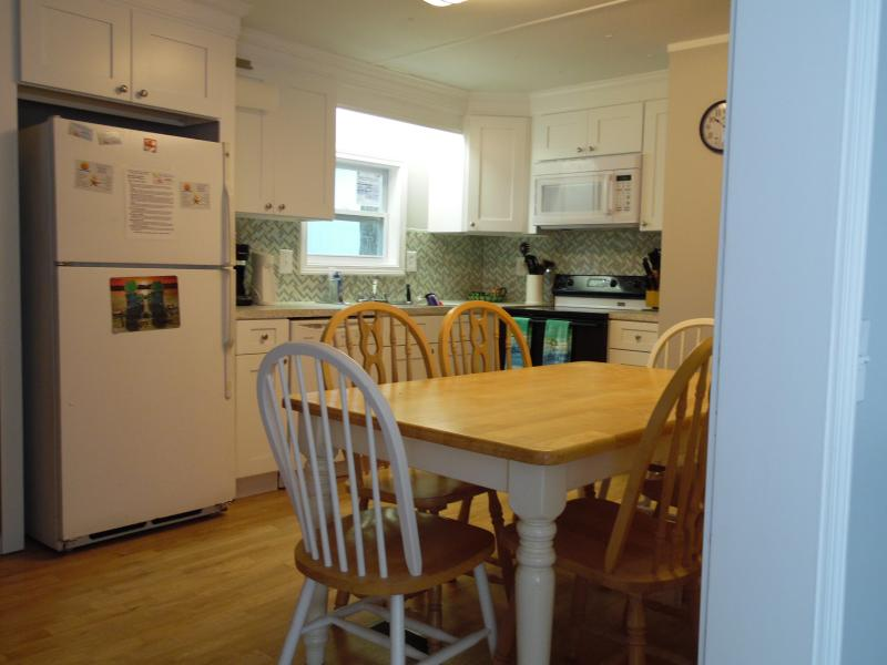 Kitchen, all full-sized appliances including stove, refrigerator, dishwasher, microwave.