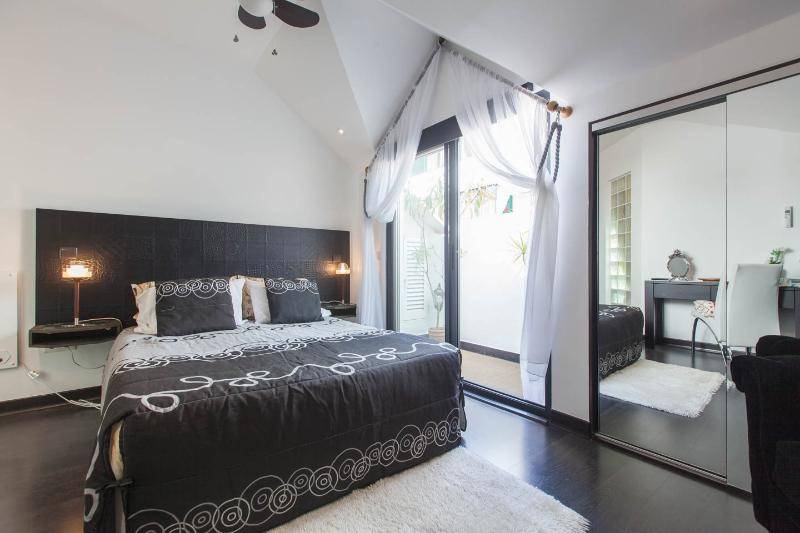 Bedroom with its own balcony and fitted wardrobe plus remote controlled ceiling fan