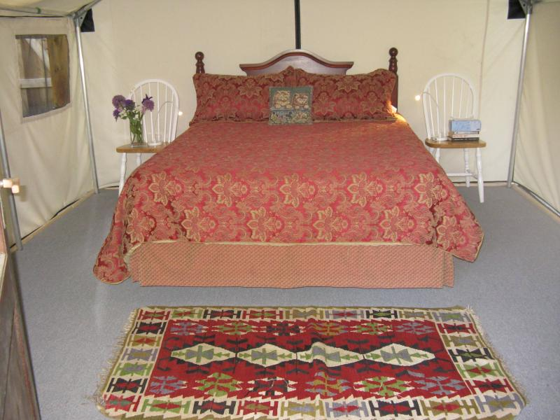 Queen size bed with linens and down pillows & duvet