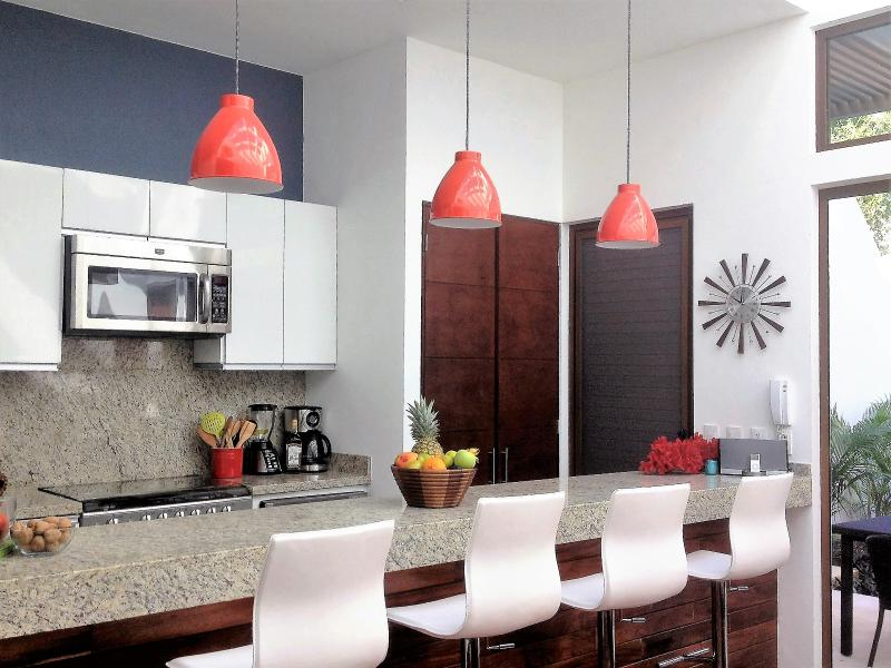 Kitchen with granite and stainless steel appliances