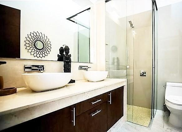 Master bath with waterfall faucets
