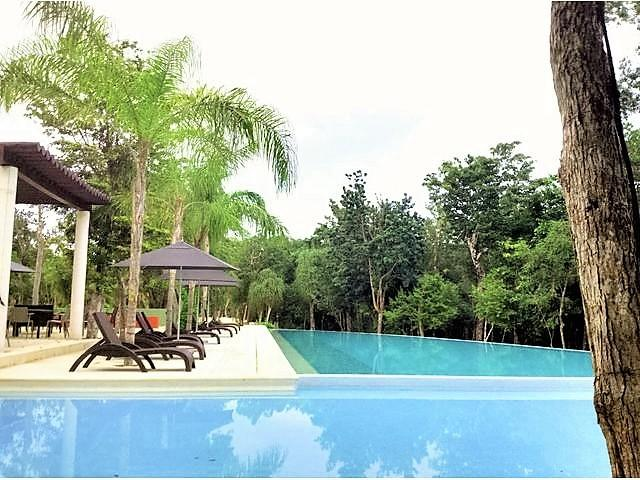 Infinity pools, loungers, bbq and dining areas