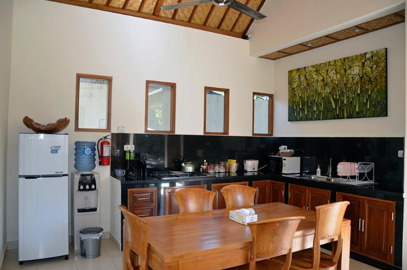 The fully equipped kitchen is beside the  dining area.