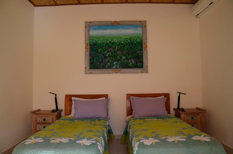 The second bedroom has 2 single beds that can also be made up as a king,