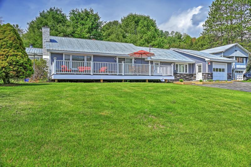 Let this charming Northville vacation rental house serve as your home base for your next lakeside getaway!