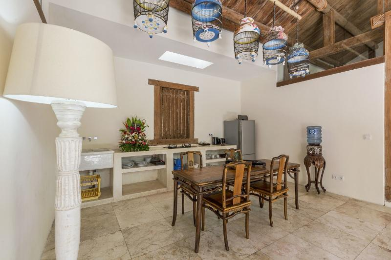 Well equipped dining room & kitchen includes large fridge stocked with drinks at supermarket prices.