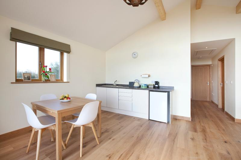 Dining table and kitchenette at Mill View Barns