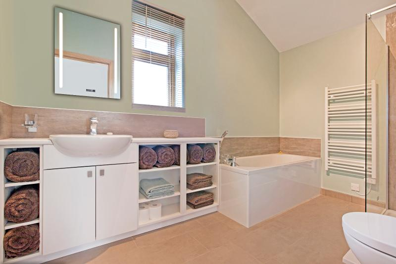 Fully stocked bathroom with linen and Neal's Yard products