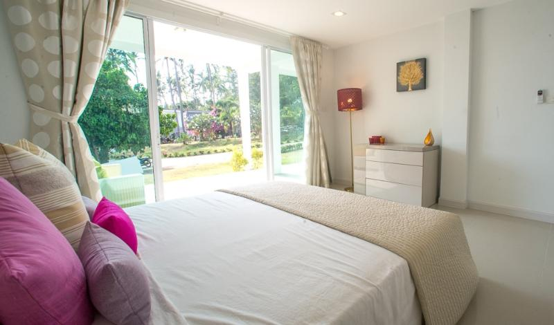 Master bedroom opening onto private balcony and garden