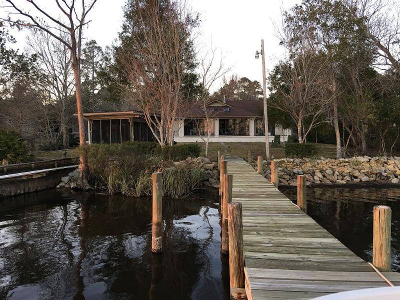 View of the back yard and house from the pier