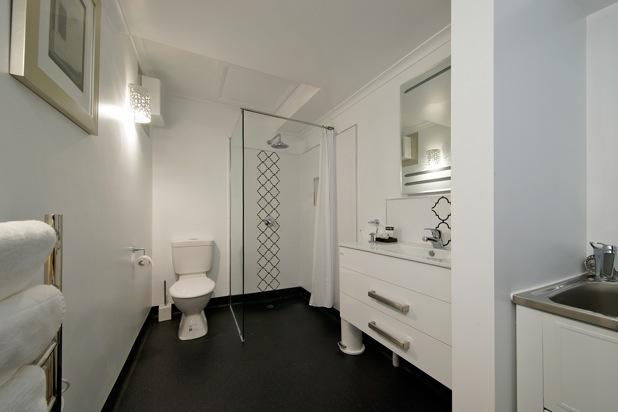 Bathroom with overhead shower head, heated towel rail and in-house laundry facilities.