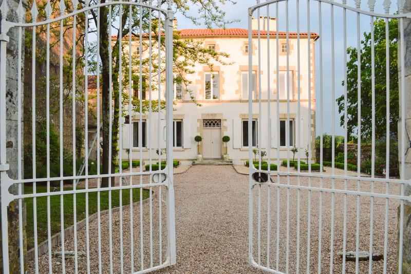 Property sits behind large cast iron gates