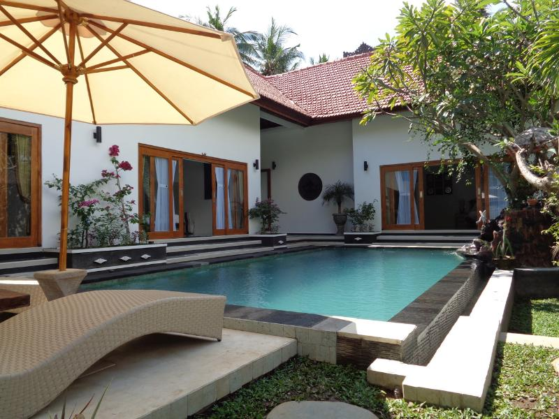 Swimming pool with long chair area