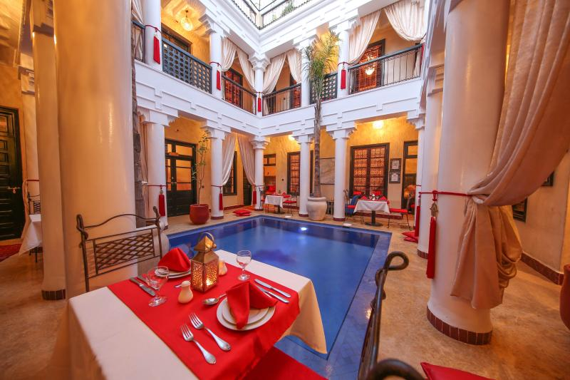 Dining by the pool at Riad Africa