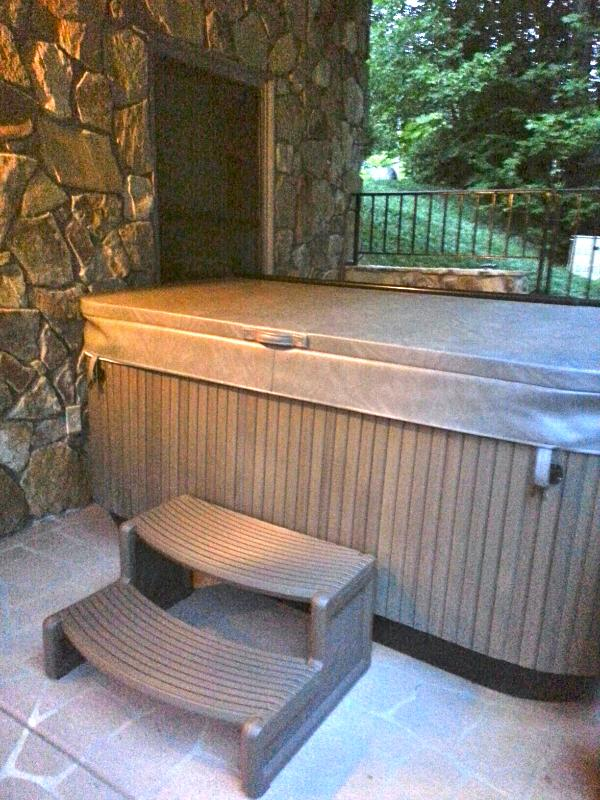 Relax in the privacy of your back porch hot tub with basement bath steps away!