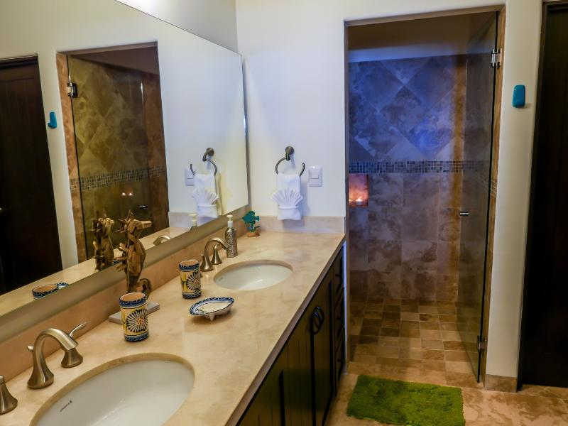 Marble counter double sink, large walk in shower with large rain shower head