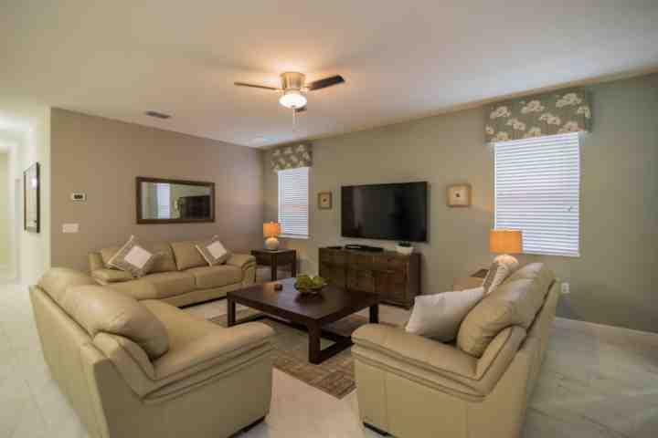 Beautiful Modern Living Area with Flat Screen TV, Leather Seating and Pool Access